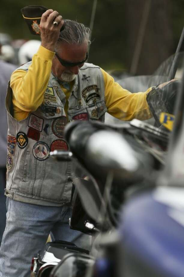 Steve Allison, Veterans of Foreign Wars chaplain and Patriot Guard Rider, prepares to head home after escorting the Vietnam Traveling Memorial Wall on Wednesday from Conroe to First Baptist Church in Magnolia. The wall will be set up and displayed in Magnolia until Nov. 12. To view or purchase this photo and others like it, go to HCNPics.com.