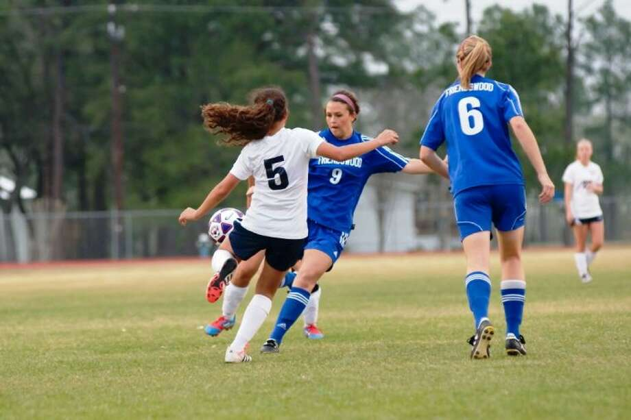 Zoe Cole of Friendswood battles Dawson's Elizabeth Rodriguez (5) while Lady Mustang Cortlyn Buck (6) looks on during a district soccer match this past week. Cole scored two goals Monday night in Friendswood's 8-0 win over Houston Reagan in a bidistrict playoff game.