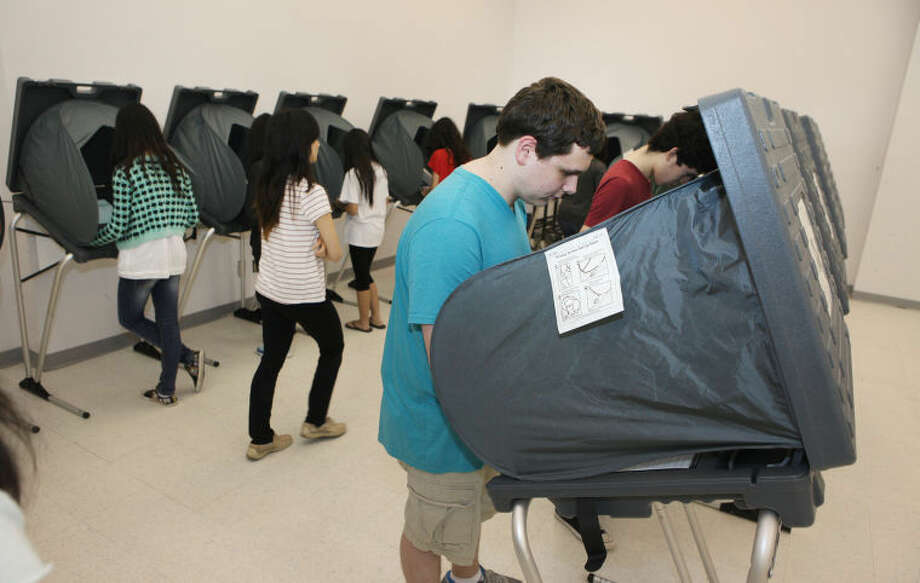 Bellaire freshman William Faour cast his votes for the school's student election using real voting equipment from an initiative by Harris County Clerk Stan Stanart's office in Houston. The equipment provide students with a real voting experience while they vote for their school's leaders.