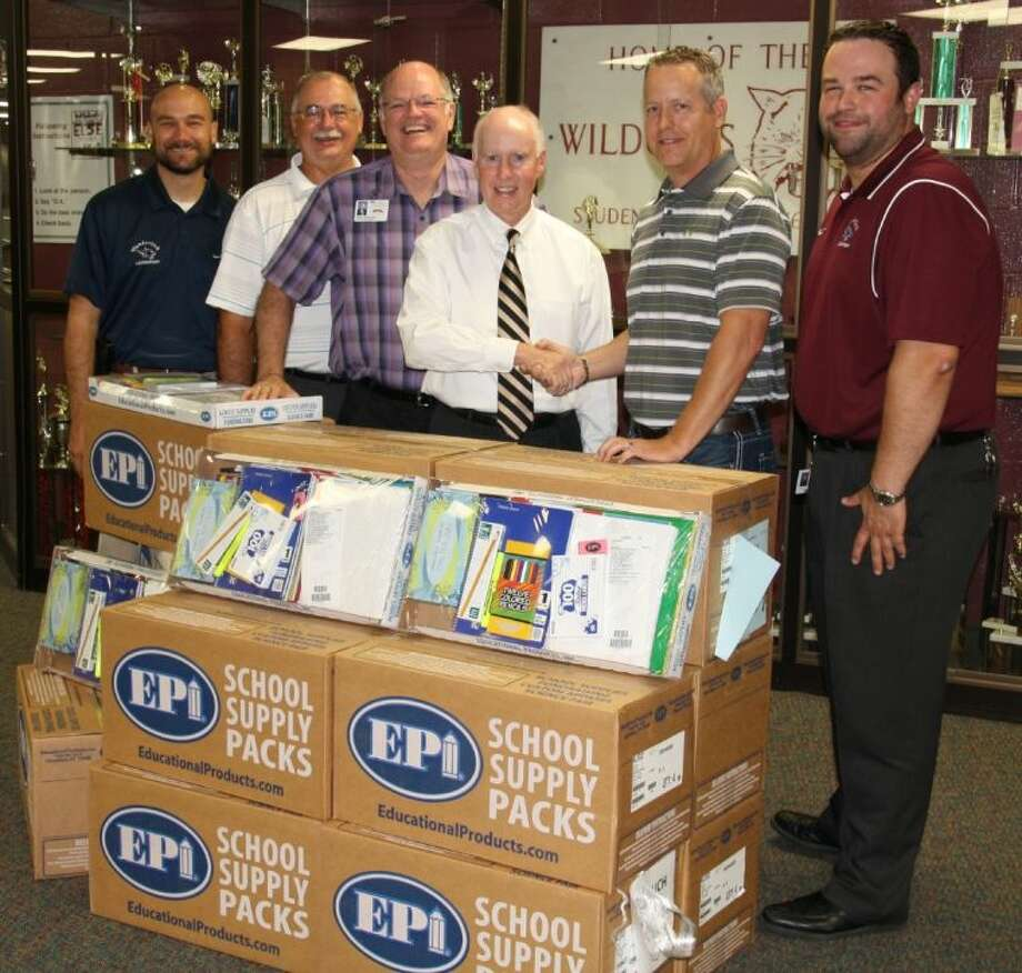 Klein ISD superintendent Dr. Jim Cain, Klein ISD employees and Tom Cobb from ICI Construction, Inc. are shown with the school supply packs.