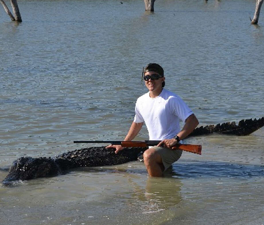 Braxton Bielski with the new Texas state record alligator taken during a public hunt on the James E. Daughtrey WMA. Bielski caught the 14-foot, 3-inch, 800-pound giant on a hook and line and then dispatched it with a rifle.