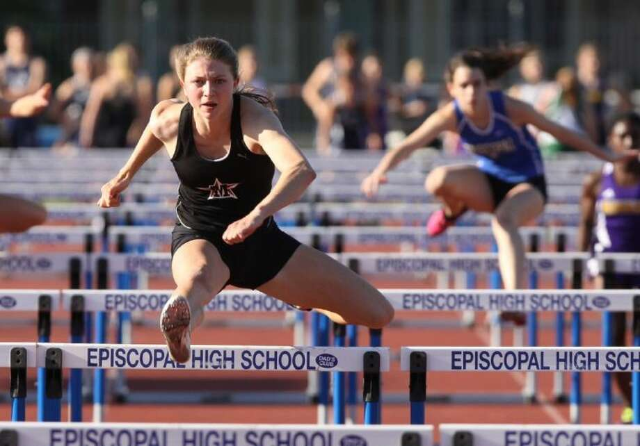 St. John's Jackie Modesett wins the girls 100-Meter Hurdles at the Episcopal Relays in Houston.Modesett won both hurdles races and the high jump to lead the Mavericks to the Episcopal Relays championship.