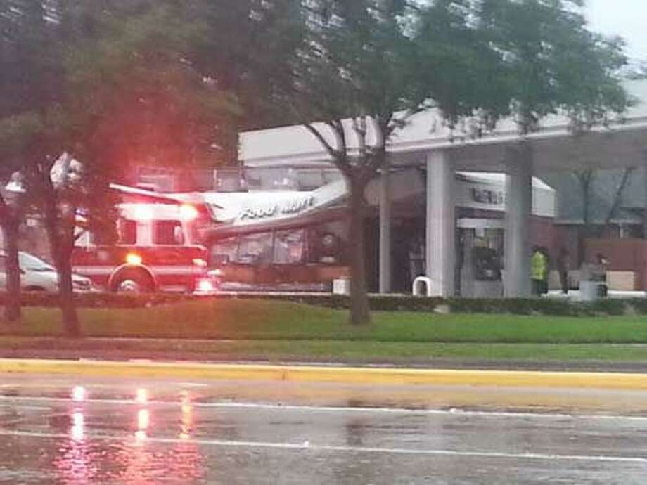 The roof of this Famis Food Market on 1700 Dulles near Lexington collapsed officials say due to the rain that collected all during the day Saturday.
