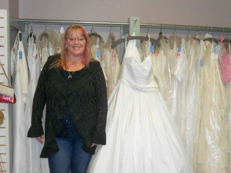 Shy Allen Faulkner Displays Some Of The Wedding Dresses That Can Be Found In Her