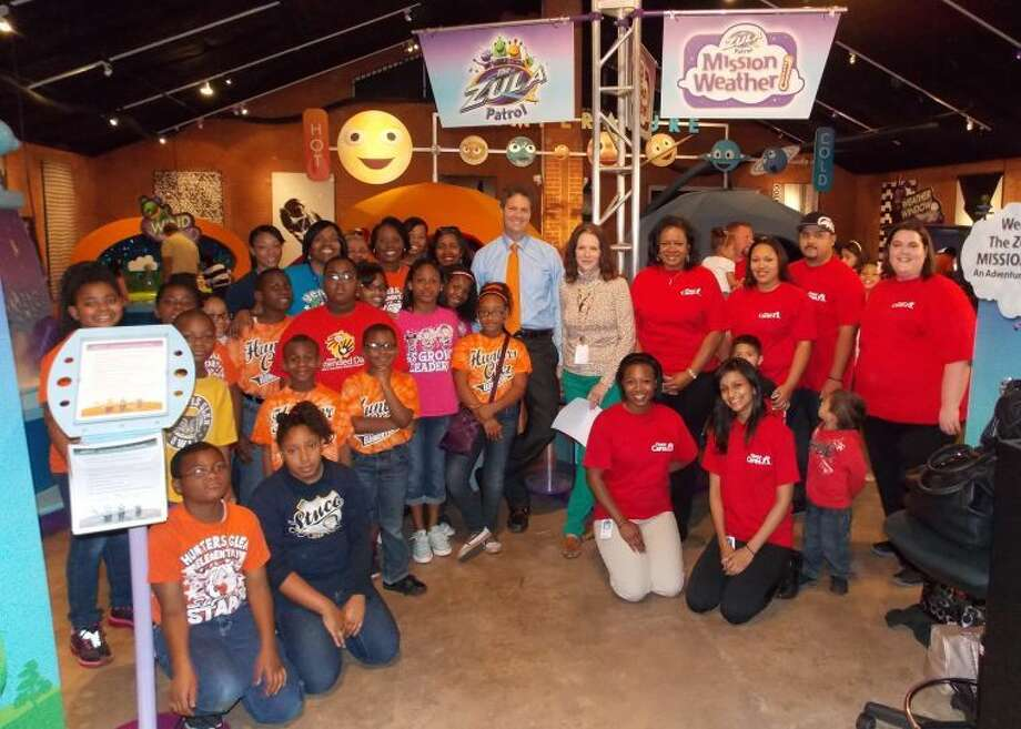 Pictured are Hunters Glen Elementary School students and staff, Fluor Corporation employees, Museum representatives and meteorologist David Paul.