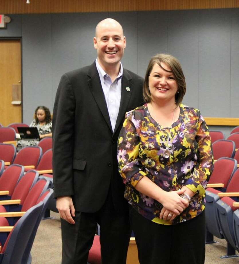 Pearland City Councilmember Scott Sherman (left) serves as the council's liaison to the Library Board. He took a moment to congratulate newly re-appointed Library Board Member Crystal Carbone at a council meeting held Monday (Oct. 14).