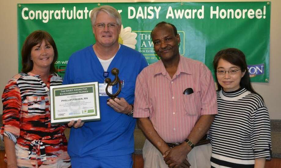 DAISY Award Recipient, Phillip Fisher, RN, with his wife Linda Fisher and Mr. and Mrs. Batamo.