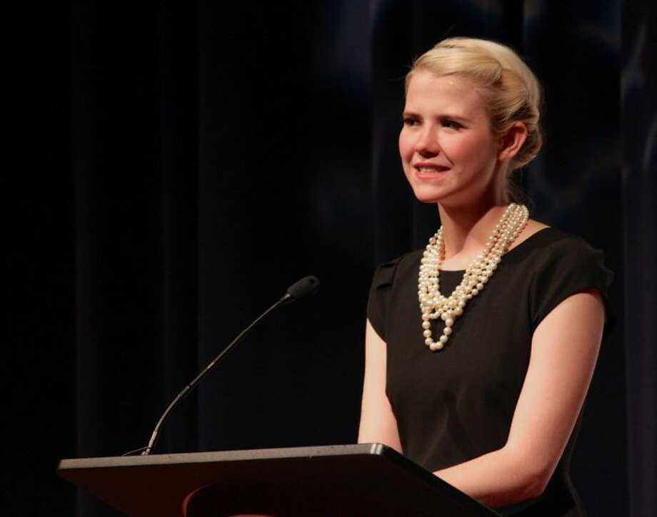 "Kidnapping survivor and child safety advocate Elizabeth Smart speaks at a press conference before her speech ""Overcoming Adversity"" on Thursday, May 9, at the Berry Center in Northwest Houston."
