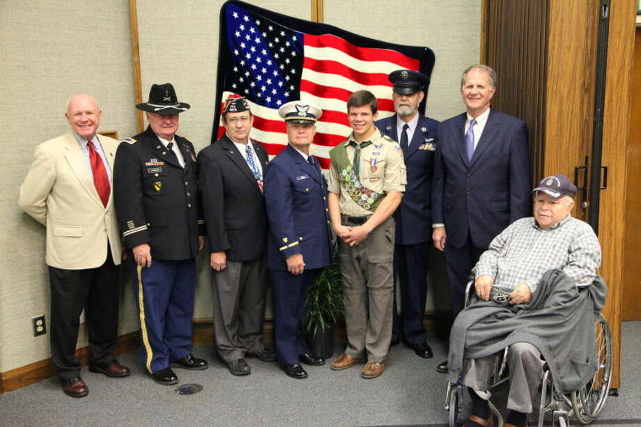 Local dignitaries recently honored Eagle Scout Spencer Goodman in a ceremony. Shown are, from left,John Heimburger, James Rodgers, Cecil McConnell, Mike Riley, Spencer Goodman, Jim Haycraft, Congressman Ted Poe and Dr. William Stewart.