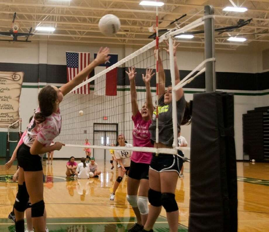Kaylie Plair goes up for the spike at the Kingwood Park Volleyball Camp.