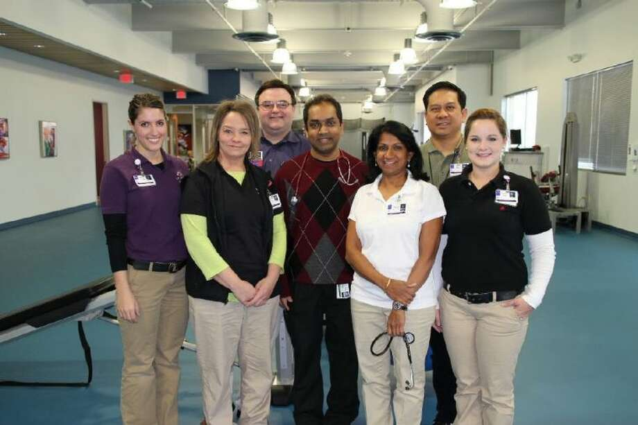The team at St. Luke's Cardiac Rehabilitation Clinic, which recently opened at St. Luke's The Woodlands Hospital inside St. Luke's Performance Medicine, includes, from left to right: Jenna Randle, physical therapy technician; Trisha M. Basham, EKG technician; Craig Johnson, RRT AEC, director of Therapies, Sleep and Neurodiagnostics; cardiologist Sanjay Patel, MD, FACC; Rhohini Chandrashekar, PT, MS, CCS, certified cardiovascular and pulmonary clinical specialist; Eric Marquez, RRT, respiratory therapist; and Stephanie Branch, CET (ACA), CPT, physical therapy technician.