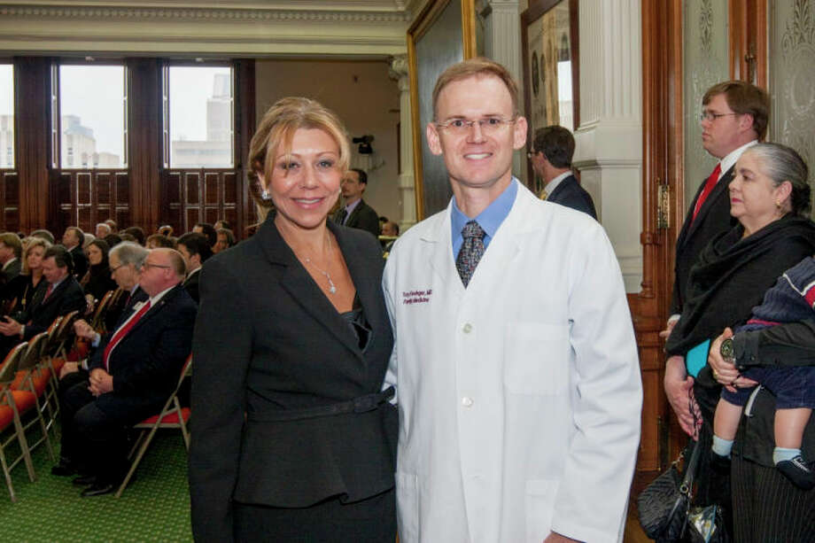 Sugar Land's Dr. Troy Fiesinger and Senator Joan Huffman (R-Southside Place) on the floor of the state Senate. / Texas Senate Media Services