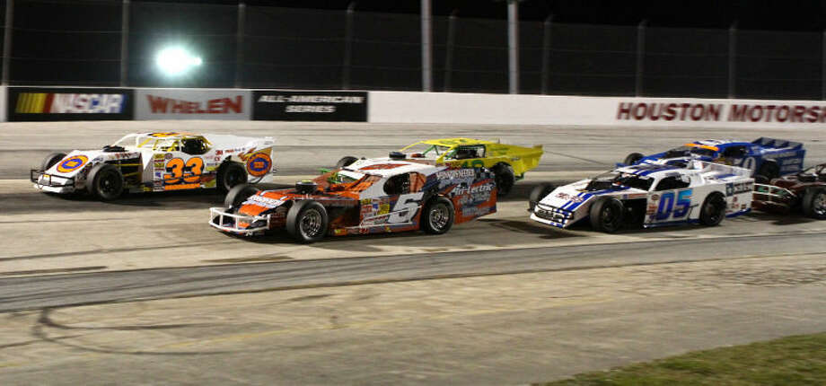 NASCAR Fiesta Modified drivers Zak Hausler, No. 5, and Jason Morman, No. 33, battle up front during the Fiesta 75 on Saturday night during the season opener at Houston Motorsports Park.