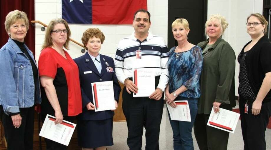 "COCISD's Spotlight on Excellence this month recognized the following ""Bright Spots"" - faculty and staff members who regularly go above and beyond in the performance of their duties. Shown with COCISD Board President Barbara Moore, from left to right, are COCISD Susan Caraballo, Sgt. Rhonda Carpio, Frank Schiappa, Jamie Allen, Penny Fevola and Karen Brugman."