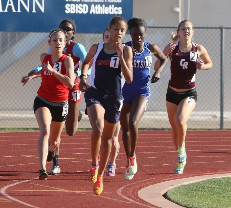 Sydney Gandy, pictured running for Seven Lakes, will represent Track Houston Youth Track Club in the 800-meter run at the USATF Junior Olympics.