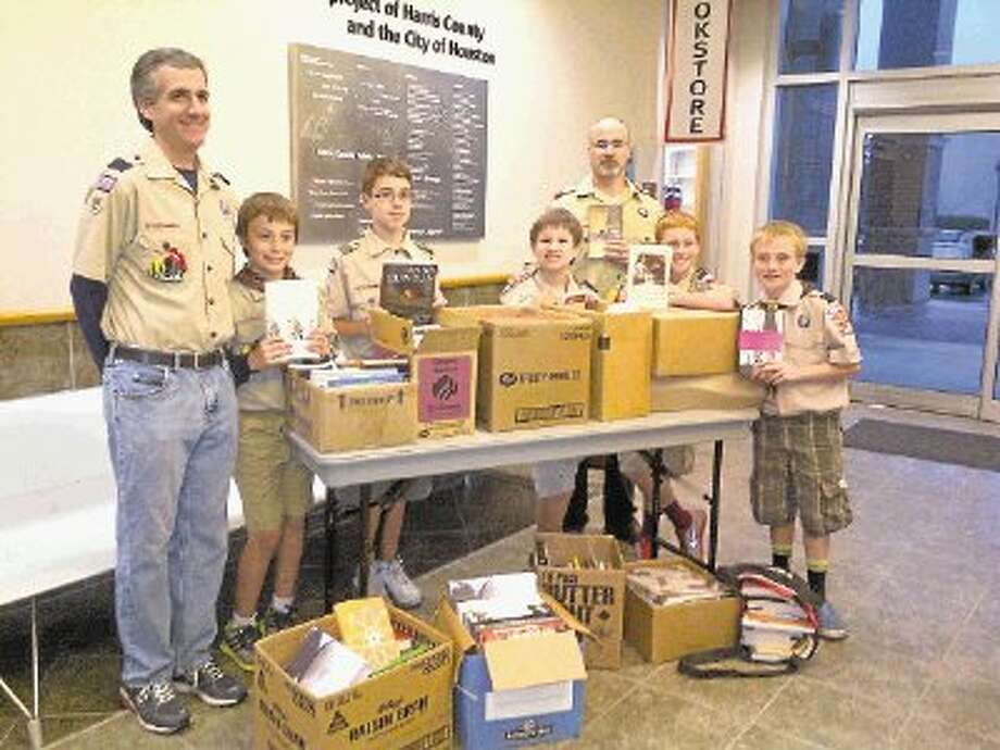 The Knight Patrol of Cub Scout Pack 958 donated 11 boxes of used books, DVDs, videos and CDs to the Friends of Freeman Library on Wednesday April 10, 2013. Items will be sold at the library bookstore to raise money for library needs and programs. The scouts were required to complete a service project benefitting their community in order to earn their Citizen Pin. They chose to help their library because they have had meetings and activities there. They collected the items from their own homes and from other members of the Scout group.Knight Patrol from Cub Scout Pack 958. From left: Leader Craig Judge, Nathan Judge, Den Chief Xander Rodriguez, Zachary Rodriguez, Asst Leader George Rodriguez, Christian Whitehead, and Jacob Straube / @WireImgId=2623281