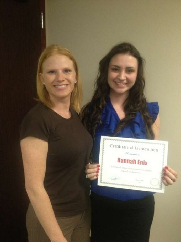 Vickie Tate and Hannah Enix were recognized at a recent Splendora ISD board meeting.