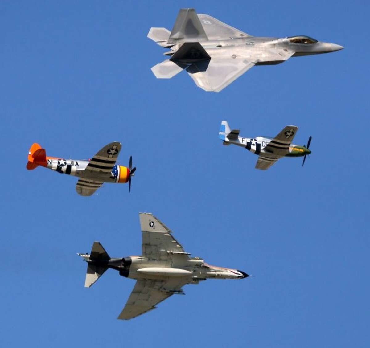 """Leading the Heritage Flight from the 2012 Wings over Houston Airshow is """"Galveston Gal"""", a P-51 from the Lone Star Flight Museum. The P-51 crashed Wednesday October 23, 2013 near Galveston Texas in West Galveston Bay."""