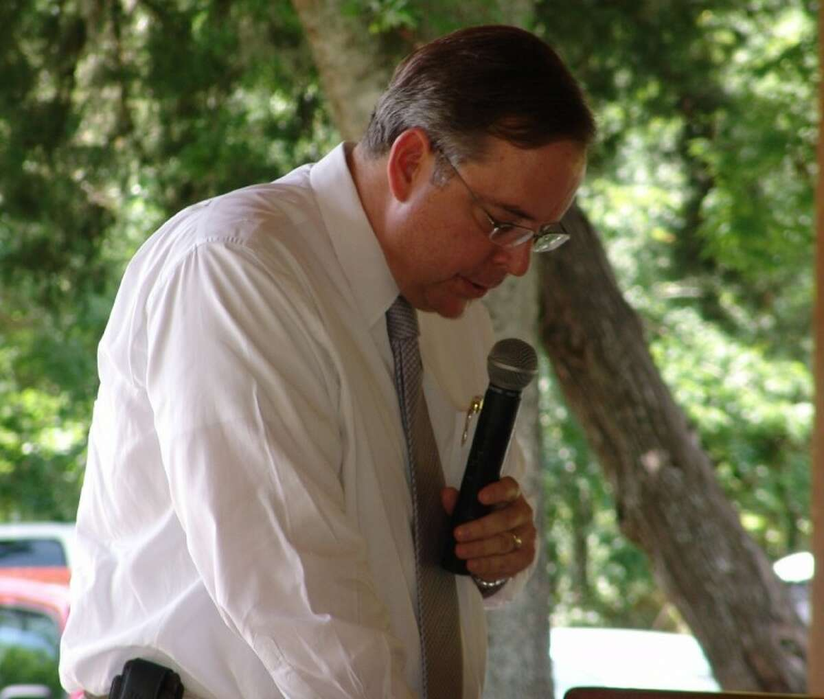 Galveston County District Attorney Jack Roady, pictured during a 2012 prayer service in Friendswood, is a key figure in a lawsuit challenging the county's bail policies.