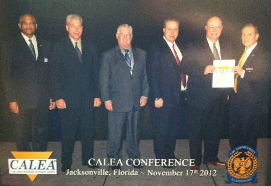 """Members of both the Deer Park Police Department and CALEA pose with Deer Park's """"Excellence"""" award at a recent ceremony held in Florida."""