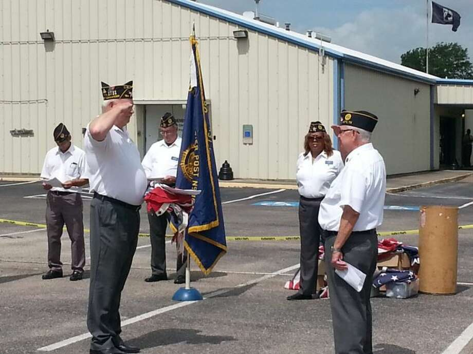 American Legion Jonathon D. Rozier Post 164 Communications Officer Paul Dudkowski and 2nd Vice Commander Monte Ikner salute each other Saturday at Post 164's flag retirement ceremony.
