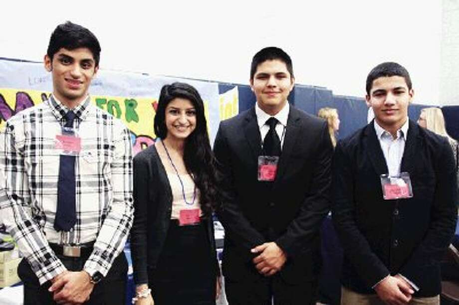 KCHS DECA/BPA students, left to right: Sunny Panjwani (DECA student), Riba Kamal (DECA Student), Martin Rodriguez (DECA and BPA student), and Khalid Noun (BPA student).