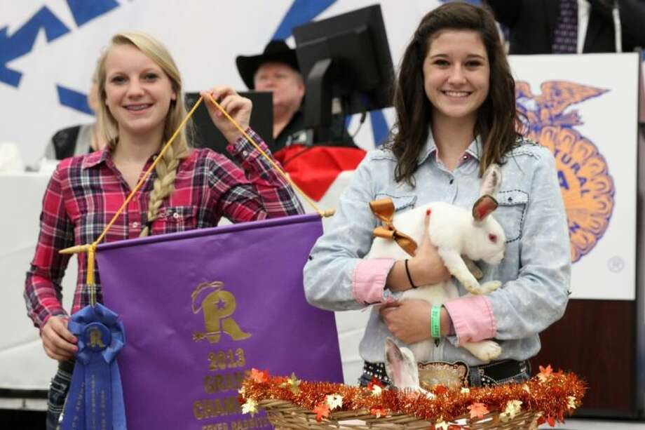 Grand Champion Rabbits winner Hannah Brady prepares for the live auction results.