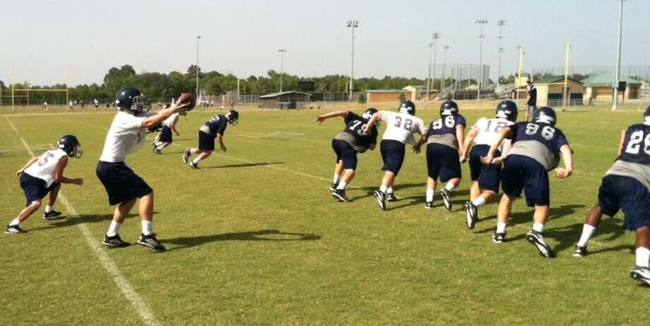 The Wildcats run a play on offense during their third day of practice, Wednesday on campus. This will be their first season with a senior class.