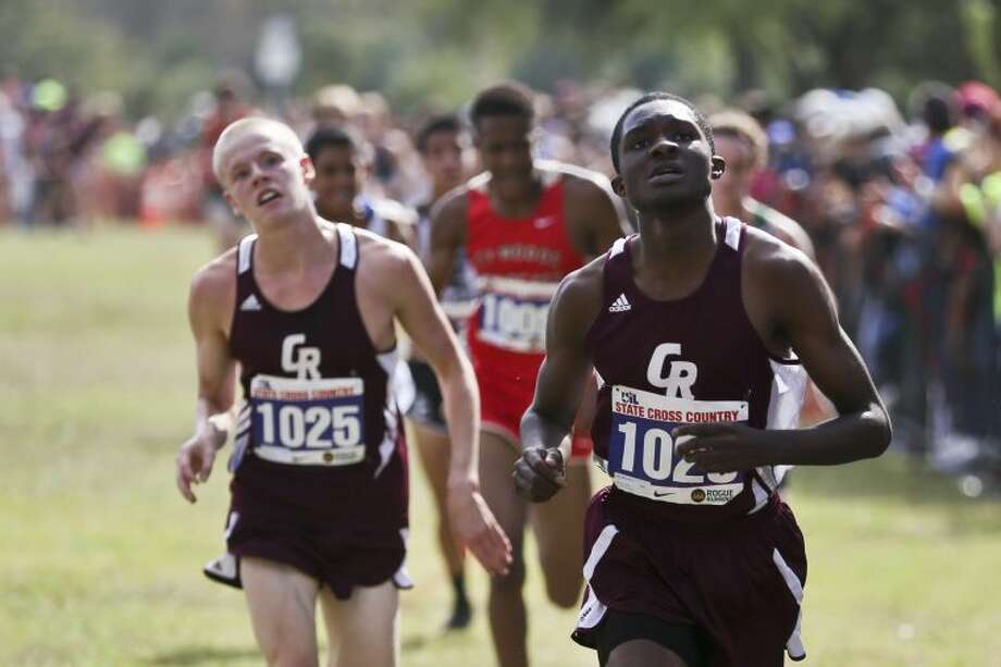 Jarrod Ballou (right) and Nathan Gift led Cinco Ranch to a ninth-place finish at the UIL State Cross Country Championships Nov. 9 in Round Rock.