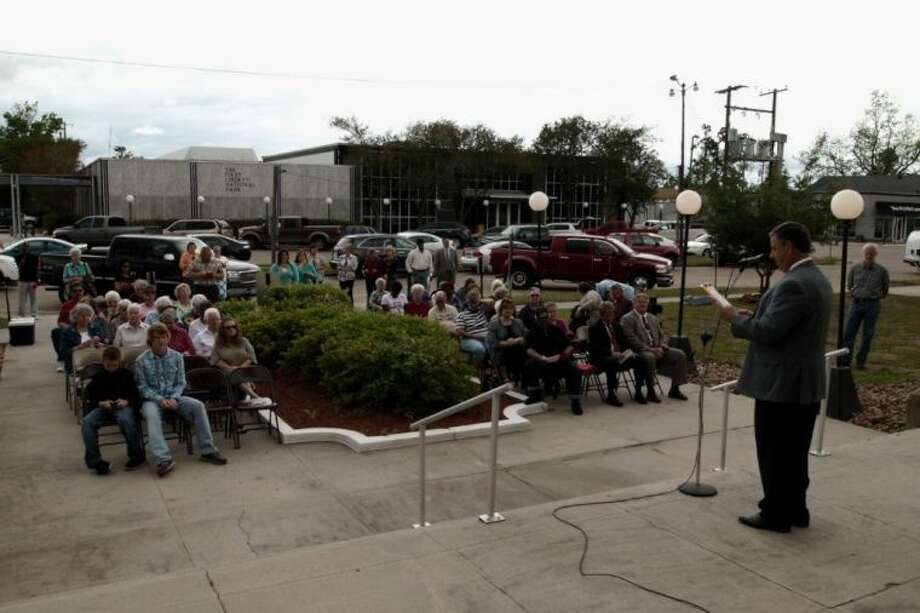Bro. Tony Hines of Hardin Baptist Church addresses the crowd gathered on the south side of the Liberty County Courthouse for the May 2 observance of National Prayer Day.