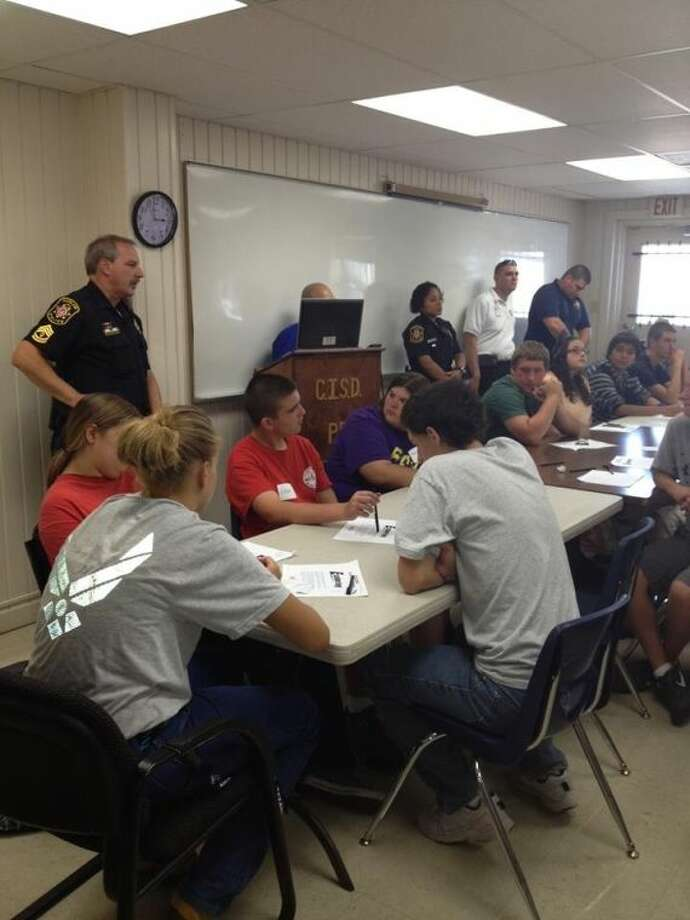 CISD Officer John Shannon and CISD Police Chief Rex Evans lead an eager group of students at their first meeting of the Law Enforcement Explorer Program.