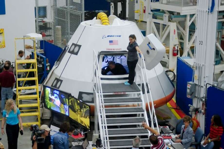 The media got a glimpse of the next generation space capsule at an event hosted by Boeing at NASA last week. The photos on this page are from the day's unveiling of the CST-100. A mock up of the CST-100 Commercial Crew Module sits in the Boeing Product Support Center Monday, July 22. Photo: KIRK SIDES