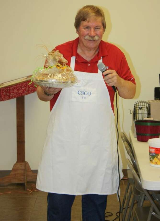 T.W. Garrett leads a live dessert auction at the Cleveland Senior Citizens Center to help raise funds in support of the meals-on-wheels program.