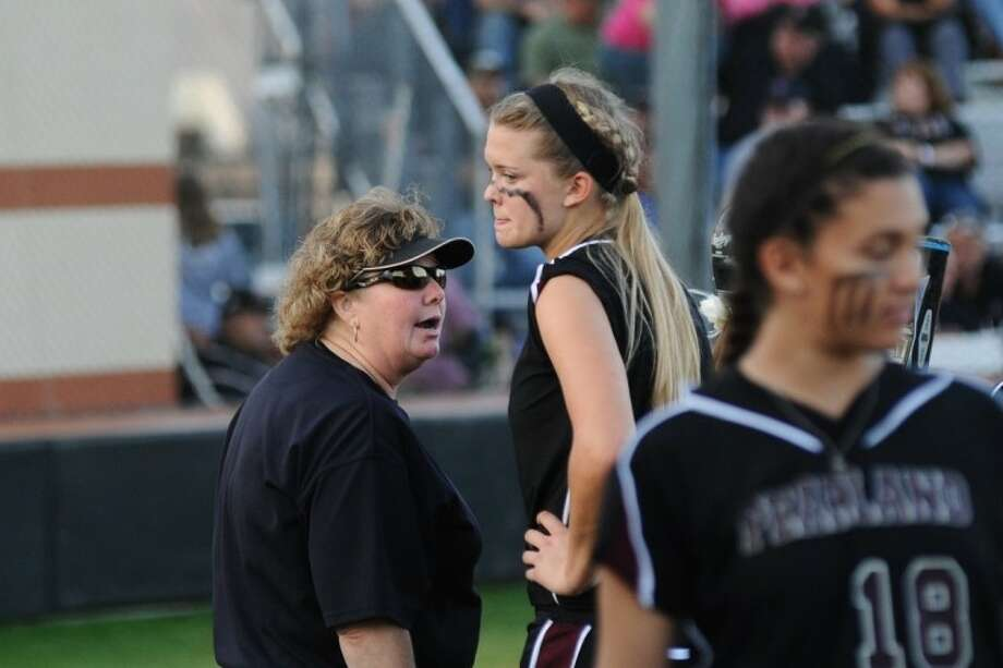 Pearland softball coach Laneigh Clark speaks to pitcher Samantha Show in the Lady Oilers' District 24-5A game against Alvin Monday night.