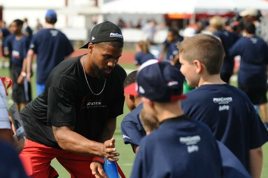 Houston Texans running back Arian Foster works with area youth during Arian Foster Football Procamp at Pearland High School, Saturday, May. 5.