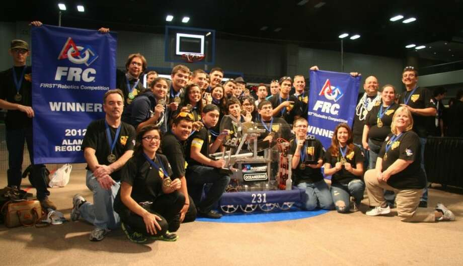 Photo of the robotics team after the team's regional victory in San Antonio.
