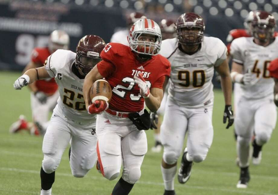 Travis' Steven Oliver breaks free for the clinching touchdown against Deer Park during their Class 5A Division I area playoff Nov. 24 at Reliant Stadium. The Tigers won 28-19 and return to Reliant Stadium to play Lamar at 7 p.m. Dec. 1.