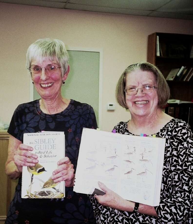 """Mary Yurkovitch, left, holds the book """"The Sibley Guide to Bird Life;"""" and Louise Keck, right, president of the Pasadena Poetry Society, of Texas assists with an open book. The pair read parts of items or poems to support Yurkovitch's program. Any poets, or those who are interested in listening to the reading of poetry, are welcome to attend any meeting. They are held on the second Saturday of each month at Sunset United Methodist Church, located on Allendale in Pasadena. Meeting time is 1 p.m. to 3:30 p,m."""