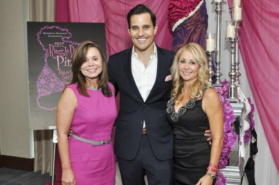 Razzle Dazzle Pink co-chairs Wendy Mitchell and Julie Comiskey with keynote speaker Bill Rancic.