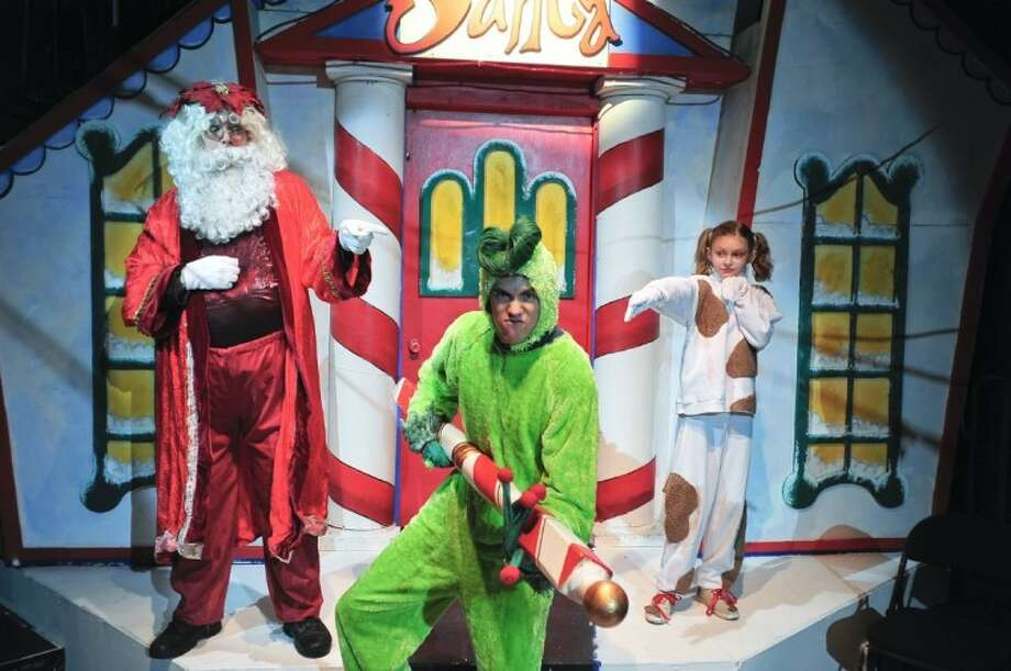 "Max (McKenzie Ivins, guest artist from Deer Park, right) and Santa (J. D. Mathis, also from Deer Park) catch the Ol' Meanie (Zac Kole, guest artist from Missouri City) stealing the North Pole, in San Jacinto College's production of ""Santa's Christmas Magic: The Musical."""
