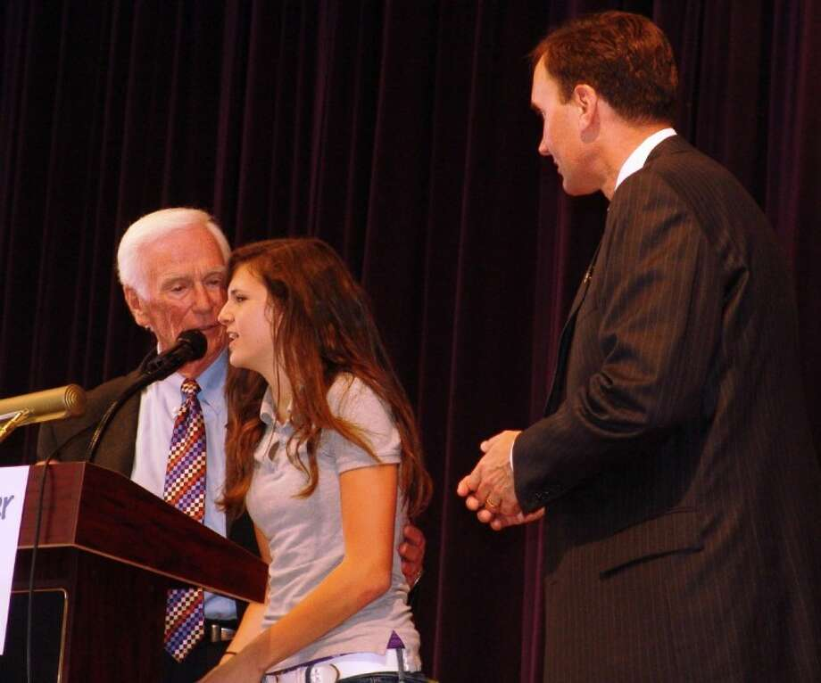 A Berry Miller Junior High School student asks former astronaut Gene Cernan (left) a question as Congressman Pete Olson listens.