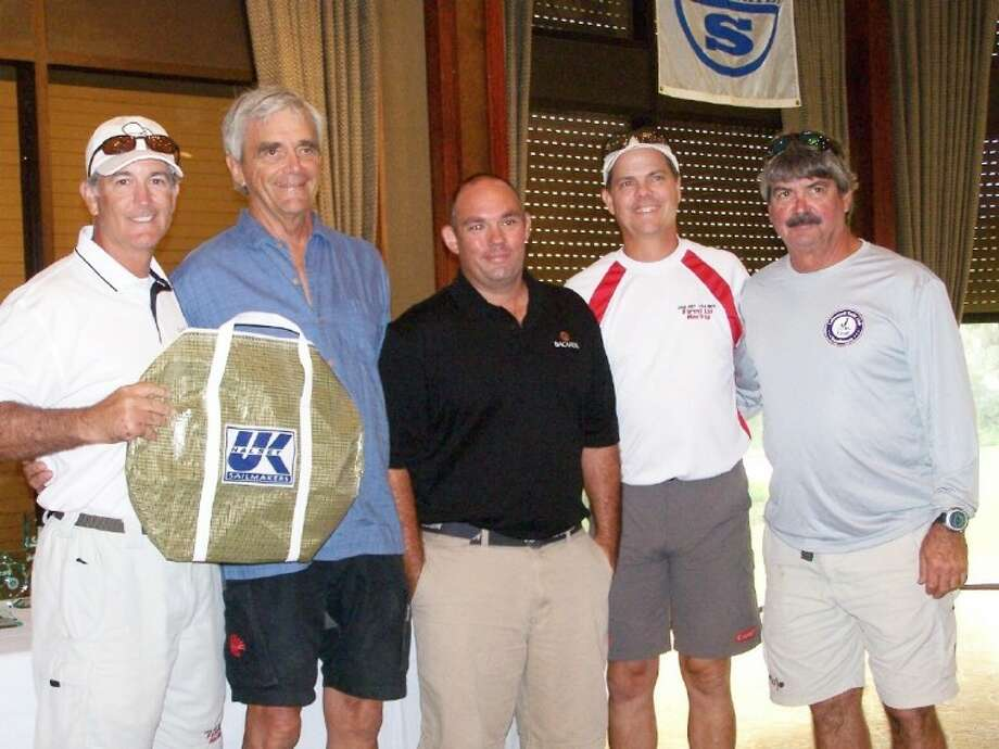 """Jay Lutz (left) and crew, 1st place in J/80 on """"USA 803"""", Rodney Johnstone beside Jay."""
