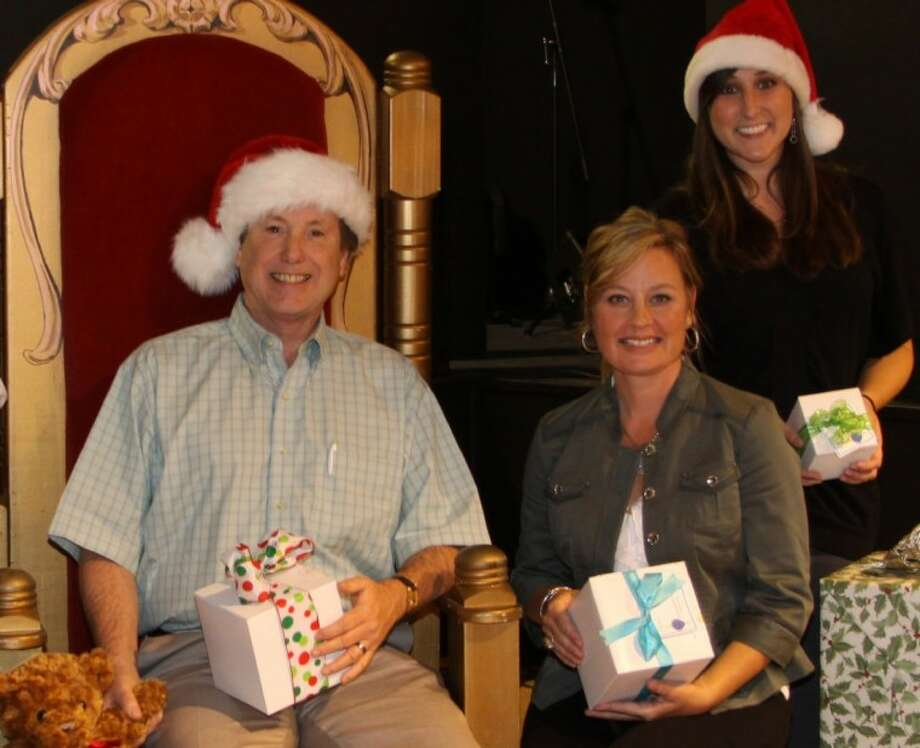 Jim McClellan of Fred and Mabel R. Parks Foundation, Child Advocates of Fort Bend Events Specialist Lisa Moore and Development Coordinator Alyson Tomasello are getting ready for the 2012 Christmas Home Tour.