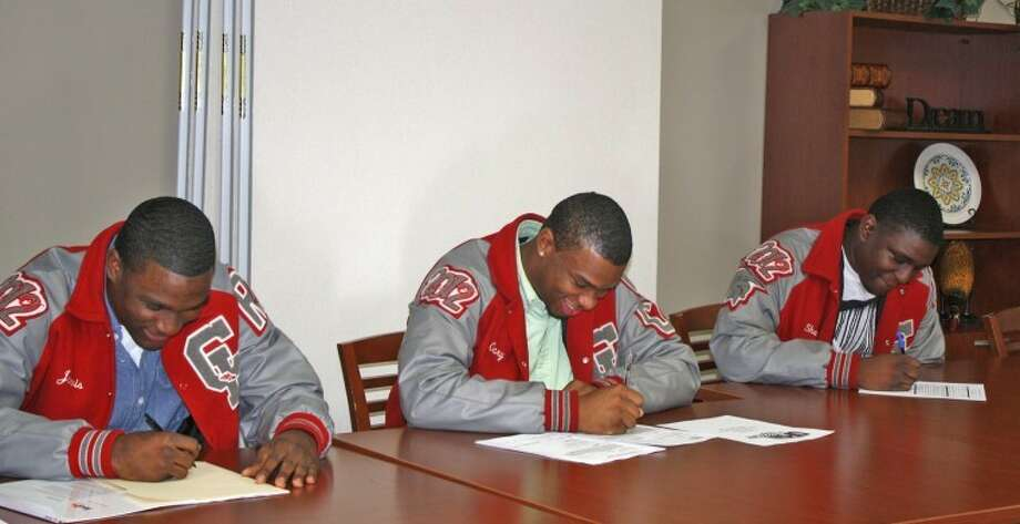 Pictured, from left to right, are Jarvis Leverett, Kansas State ; Gary Howard, Panhandle State; and Shaquille Clinton, Blinn College.