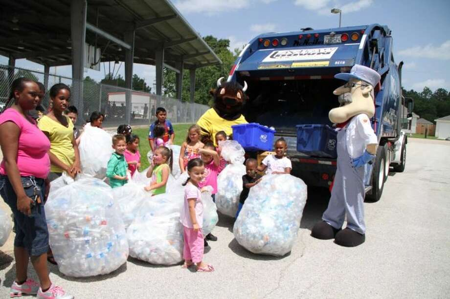 Children recycle bottles with WCA Waste in Tomball The Tomball. WCA is expanding its footprint in the Houston market, the company said Tuesday, Sept. 11, 2018. Photo: Mary McKay