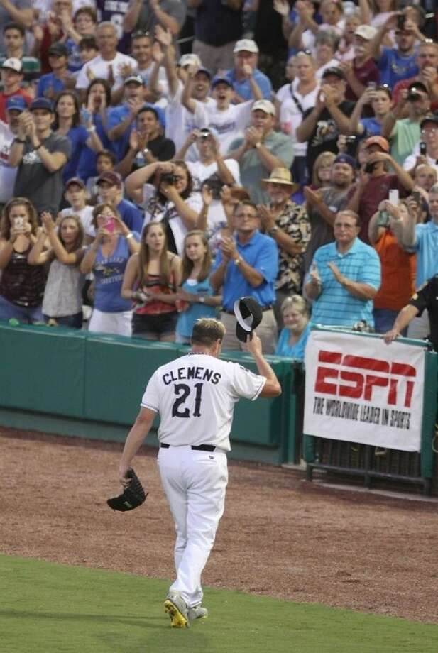 Seven-time Cy Young Award winner Roger Clemens exits to a standing ovation Aug. 25 following his first professional start in five years. The Houston native made his second start for the Sugar Land Skeeters on Sept. 7 at Constellation Field, pitching to his son Koby.