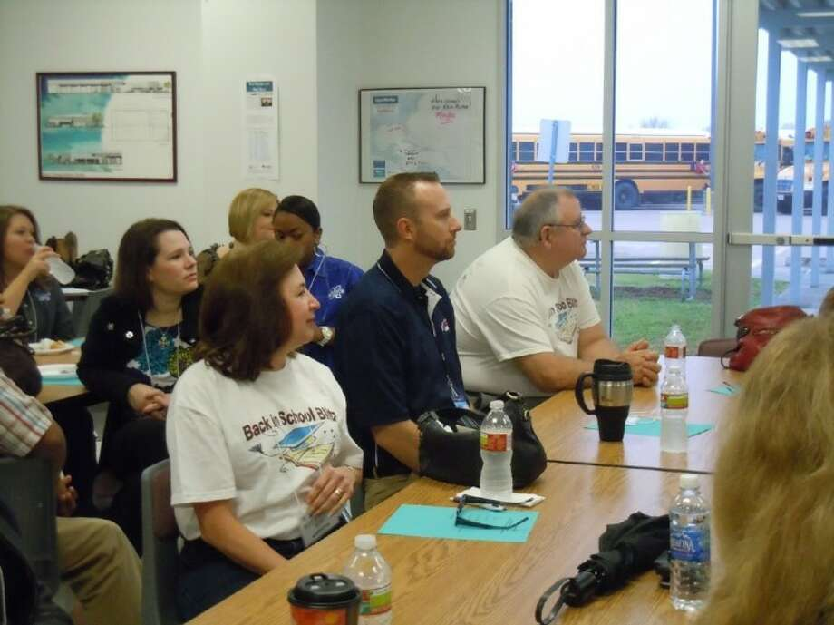Blitz volunteers attend training prior to visiting with students