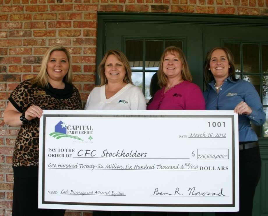 The Capital Farm Credit board of directors recently declared a total patronage refund of $126.6 million. Presenting the ceremonial check to stockholders March 6 are four staff members based at the Dayton Credit Office: From left, Office Manager Jennifer Williams, Vice President Teresa Turbeville, Office Administrator II Melissa Noel and Loan Officer Marcie Sheffield.