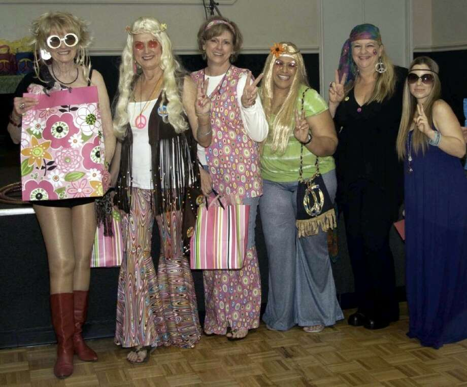 The Women in Leadership Society hosted a Bunco fundraiser that generated approximately 6,000 for programs that benefit single mothers and their children recently. More than 120 guests attended the festive 1960s-theme event.