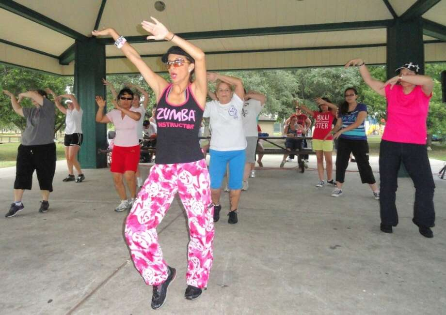 Ana Flores teaches a zumba class during this year's Fitness Day at Dow Park. Many residents took advantage of numerous fitness programs that are offered in the city.